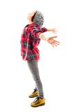 Young woman standing with her arm outstretched Royalty Free Stock Images