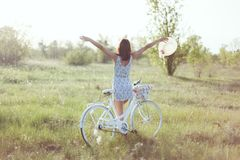 Young woman leaned on her bicycle. stock images
