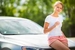 Young woman standing by her car Stock Photography