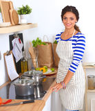 Young woman standing in her kitchen Royalty Free Stock Photo