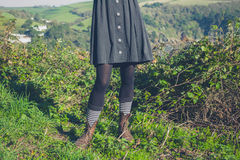 Young woman standing on a hilltop Royalty Free Stock Photos