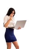 Young woman holding a laptop and doing a thumbs up Royalty Free Stock Images