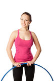 Young woman standing with hula hoop down. Half Stock Image