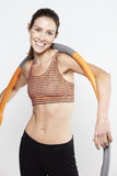 Young woman standing with a hula hoop, smiling Stock Photos