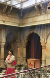 Young woman standing inside Karni Mata Temple, Deshnok, India Royalty Free Stock Photography
