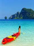 Young woman standing with kayak at Ao Yongkasem beach on Phi Phi Don Island, Krabi Province, Thailand Royalty Free Stock Photo