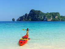 Young woman standing with kayak at Ao Yongkasem beach on Phi Phi. Don Island, Krabi Province, Thailand. Koh Phi Phi Don is part of a marine national park royalty free stock photography