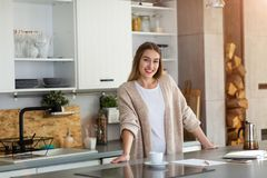 Young woman standing in the kitchen stock photo