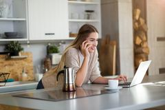 Young woman working on laptop at home stock photos