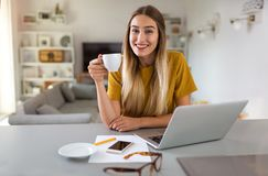 Young woman working on laptop at home stock images
