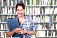 Young woman standing in library Stock Photography