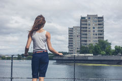 Young woman standing by marina in urban area Royalty Free Stock Photo