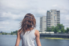 Young woman standing by marina in urban area Stock Images