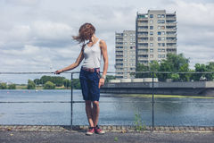 Young woman standing by marina in urban area Royalty Free Stock Images