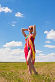 Young woman standing at meadow Royalty Free Stock Images