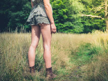 Young woman standing in meadow on sunny day Royalty Free Stock Photo