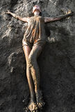 Young woman standing in the mud Stock Photography
