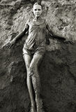 Young woman standing in the mud Stock Photo