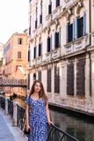 Young woman standing near banister in Venice, Italy. royalty free stock photography