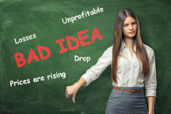 Young woman standing near big red words `bad idea` Royalty Free Stock Photo