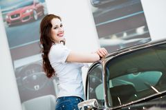 Young woman standing near a car Royalty Free Stock Images