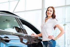 Young woman standing near a car Stock Image