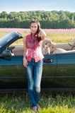 Young woman standing near car Royalty Free Stock Photo