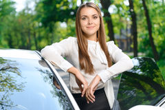 Young woman standing near car Royalty Free Stock Photography