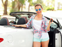 Young woman standing near a convertible with keys in hand Royalty Free Stock Photography