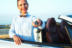 Young woman standing near a convertible with keys in hand Stock Photography