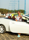 Young woman standing near a convertible with keys in hand Royalty Free Stock Images