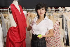 Young woman standing near the mannequin Stock Photo