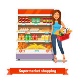Young woman standing near supermarket shelves vector illustration