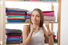 Young woman standing near the wardrobe Royalty Free Stock Image