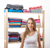 Young woman standing near the wardrobe Royalty Free Stock Photography
