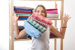 Young woman standing near the wardrobe Stock Image
