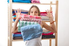 Young woman standing near the wardrobe Stock Photography