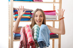 Young woman standing near the wardrobe Stock Photos