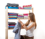Young woman standing near the wardrobe Royalty Free Stock Images