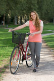 Young woman standing next to her bike Stock Photos