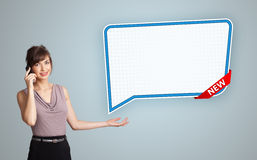 Young woman standing next to a modern speech bubble copy space a Stock Image