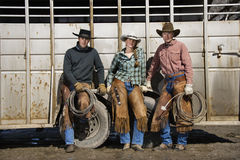 Young Woman Standing Next to Two Men with Lariats Royalty Free Stock Photo