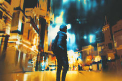 Young woman standing in night city stock illustration