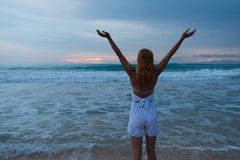Young woman standing on ocean beach Stock Photography