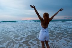 Young woman standing on ocean beach Royalty Free Stock Photos