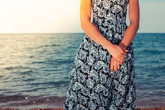 Young woman standing by the ocean Stock Photo