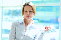 A young woman standing in office Royalty Free Stock Photo