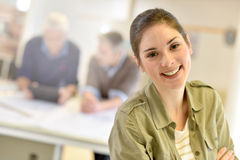 Young woman standing in office of architects Royalty Free Stock Photography