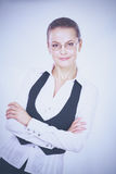 Young woman standing in office Stock Images