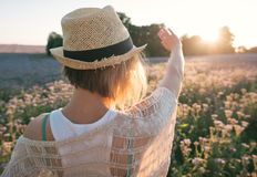 Young woman standing outdoor with sunrise on the background Stock Images